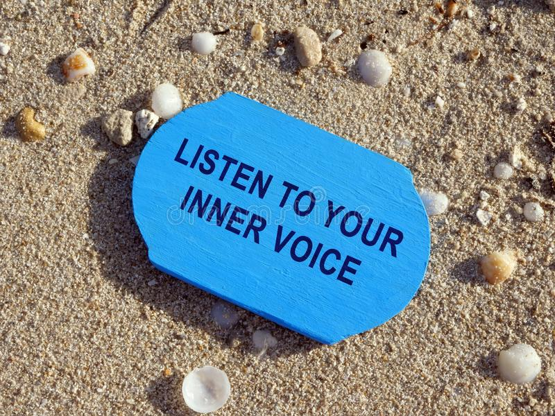 Listen to your inner voice sign. Inspirational quote royalty free stock photos