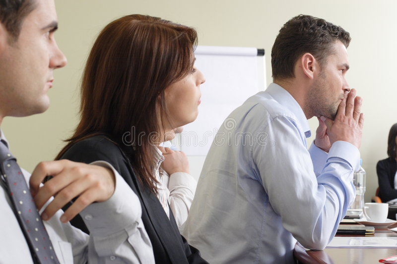 Listening leader. Group of business people at the meeting royalty free stock photography