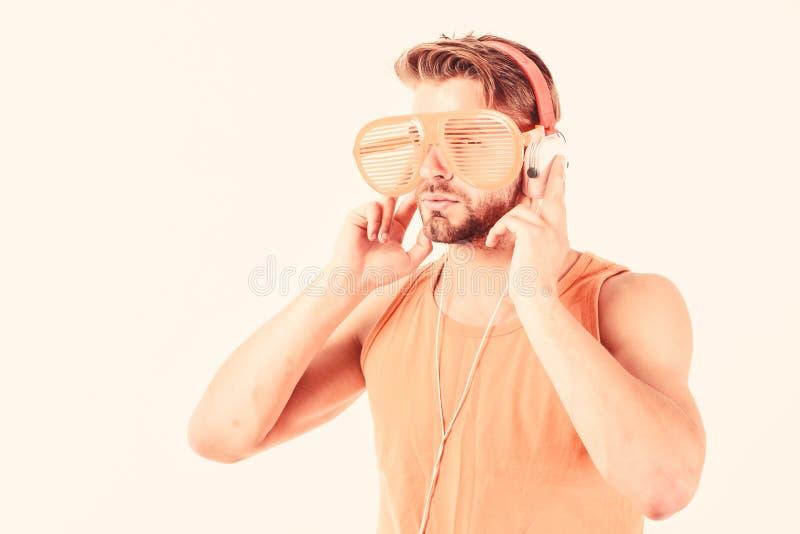 Listening Music Earphones Concept. mp3 player. sexy muscular man listen music on phone mp3 player. man with mp3 player. On phone isolated on white. unshaven man stock image