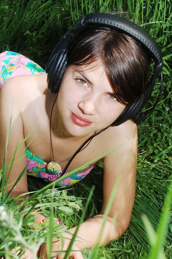 Listening music in nature stock photo