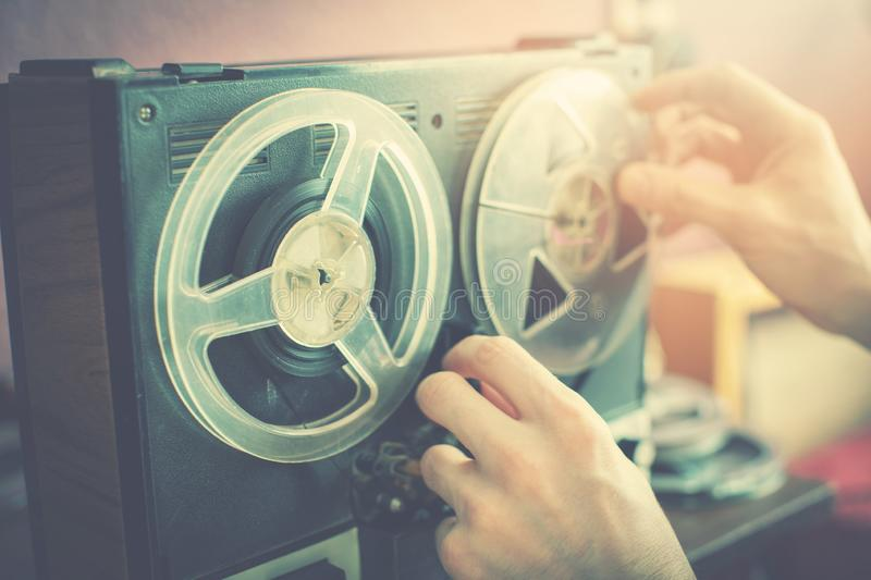 Listening old records on vintage audio reel recorder. At home stock photo
