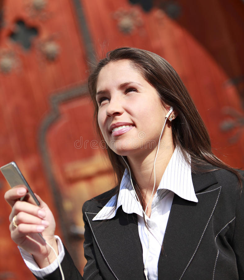 Download Listening to music stock photo. Image of face, businesswoman - 11364578