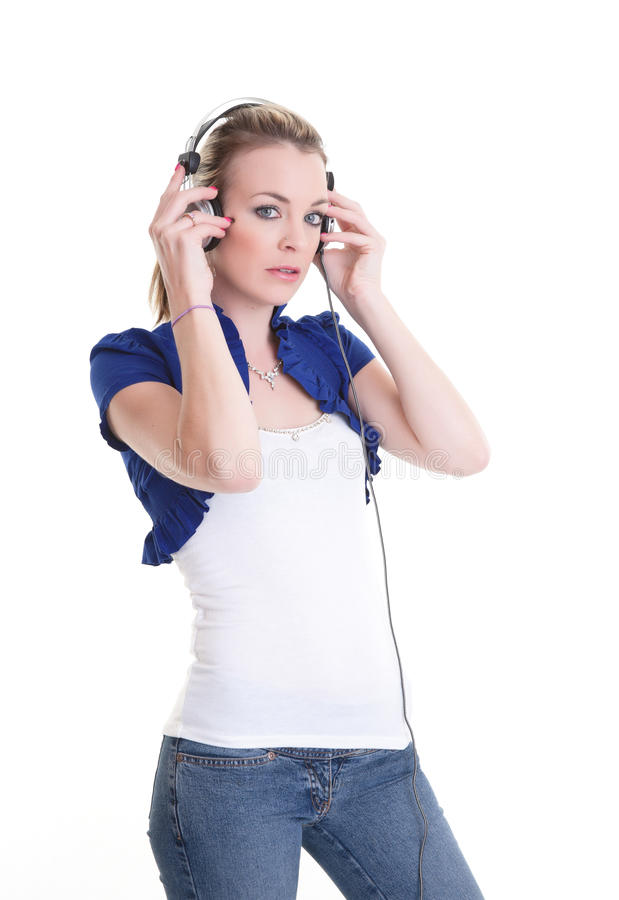 Listening to music headphones royalty free stock photography