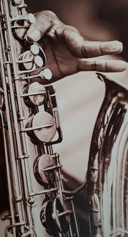 Listening to the saxophone`s notes stock images