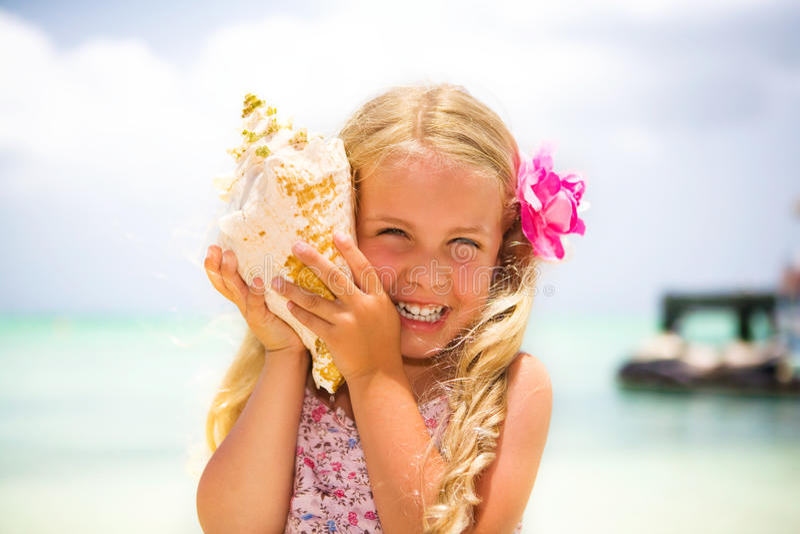 Listening to a seashell stock photos