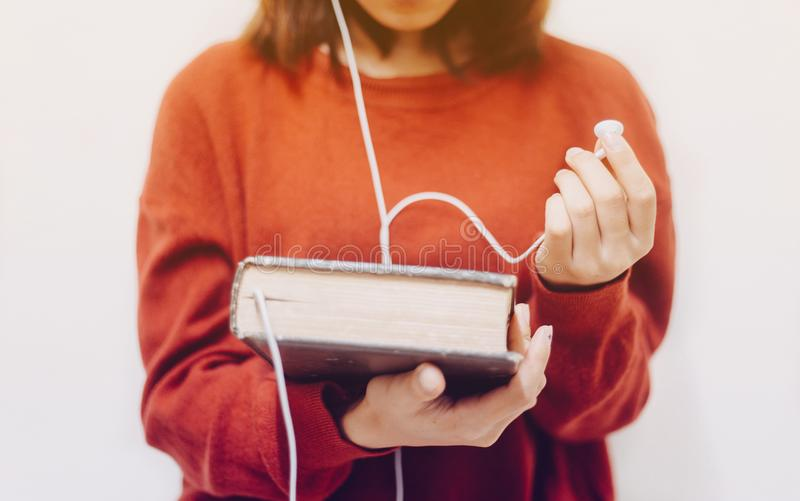 Listening the words of god concept. Soft focus of Woman holding the holy bible and headphones,Concept listen the words of God royalty free stock photo