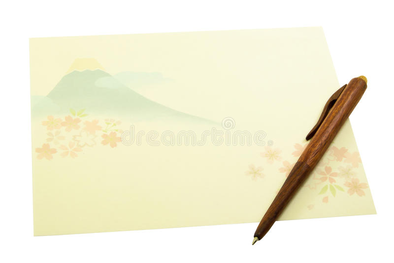 Listowy papier z drewnianym piórem na białym tle ilustracji