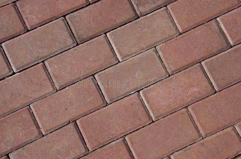 Listras diagonais da textura vermelha da pedra de pavimentação imagens de stock