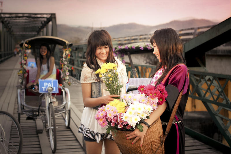 Lisu Hill tribe flower street vender and tourist royalty free stock images