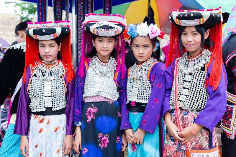 Lisu hill-tribe preteen girl wears traditional tribal attire with black circular Lisu headdress on Akha Swing Festival 2018. Doi Mae Salong, Chiang Rai stock images