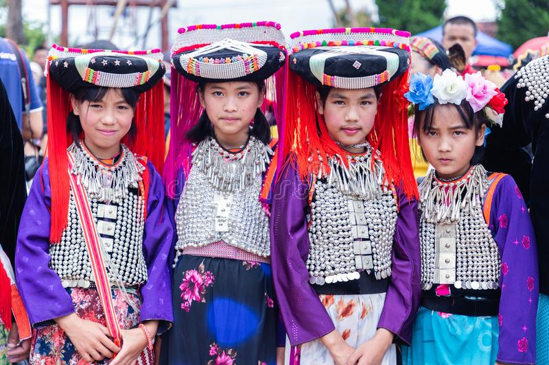 Lisu hill-tribe preteen girl wears traditional tribal attire with black circular Lisu headdress on Akha Swing Festival 2018. Doi Mae Salong, Chiang Rai stock image