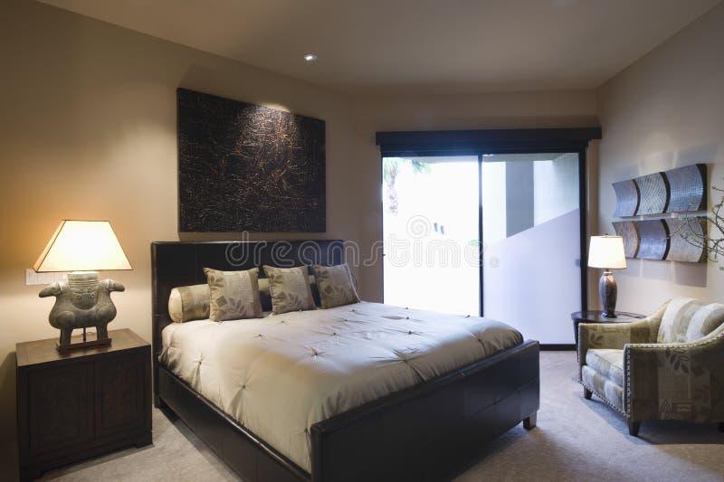 Lit Bedroom Of Home stock photos