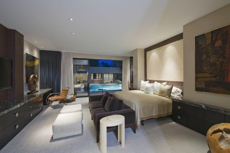 Lit Bedroom Of Luxury Home stock photos