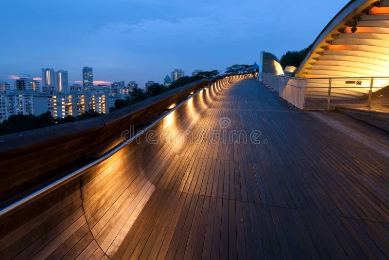 Lit bridge at dusk. Modern and lit Henderson Waves Bridge in Singapore at dusk royalty free stock photography
