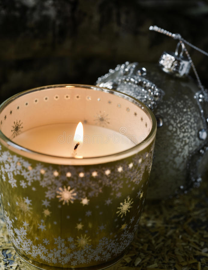 Lit candle and christmas ball royalty free stock photos