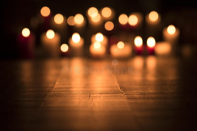 Lit candles burning in the Church royalty free stock images