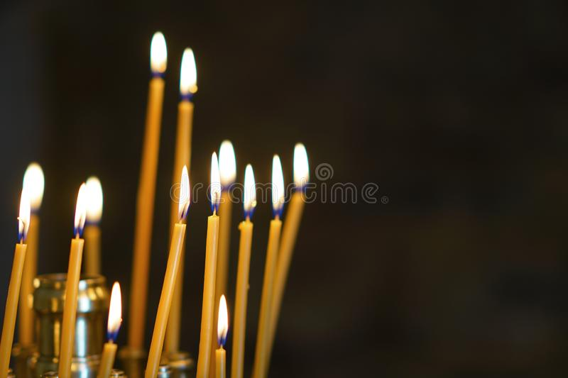 lit candles in a church in Greece royalty free stock photography
