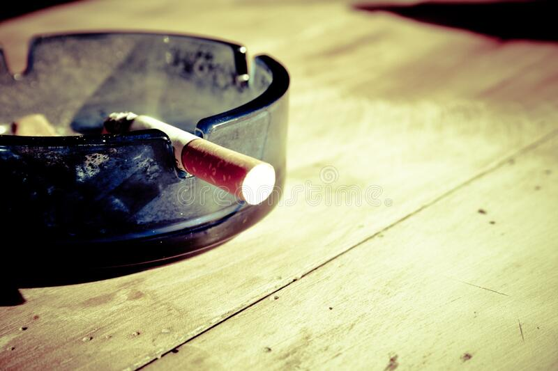 Lit Cigarette In Ashtray Free Public Domain Cc0 Image