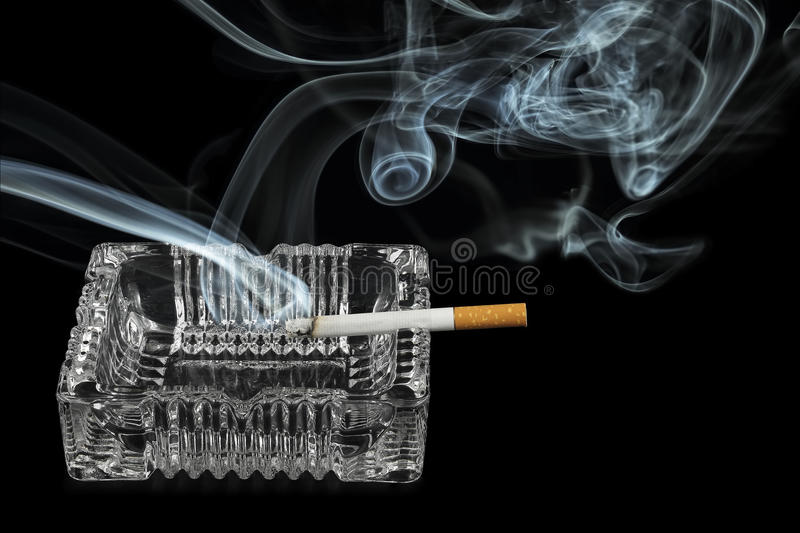 Lit cigarette royalty free stock photography