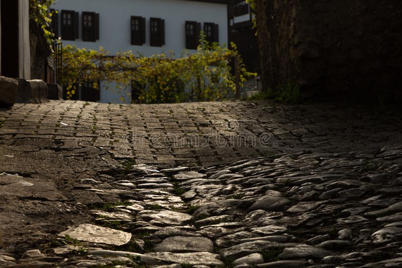 Lit cobblestones on a street. Scene with grapevines in Safranbolu, Turkey stock photo