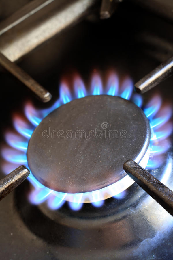 Lit gas cooker ring stock image