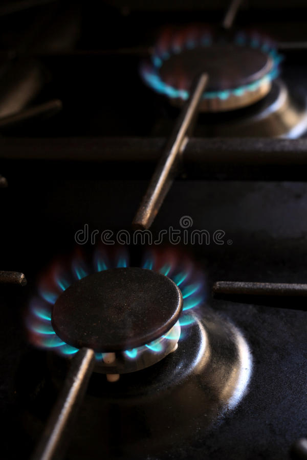 Lit gas cooker rings royalty free stock image
