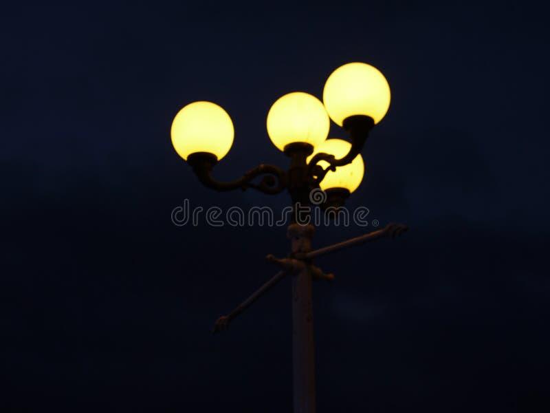 Lit lamp post at night. A shot of a Lit lamp post at nightin brighton royalty free stock photos