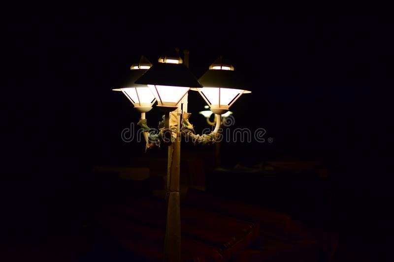 Lit Lamp in the Wadi Rum Desert in Jordan. Street Lamp turned on in the night in the middle of the Wadi Rum Desert in Jordan stock image