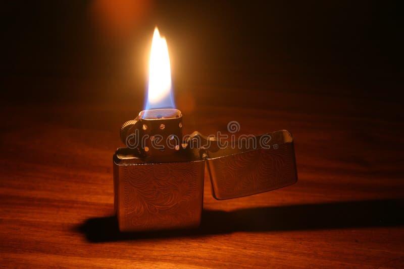 Lit lighter stock image