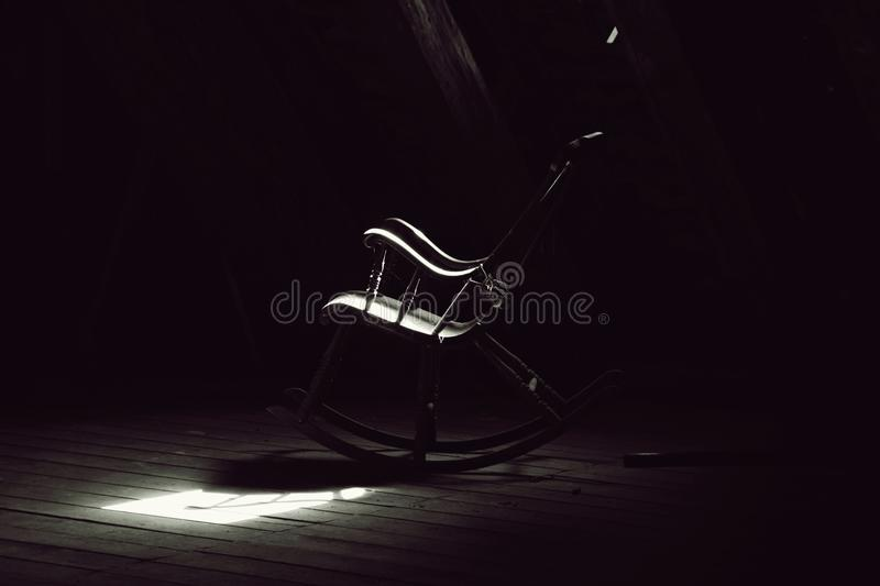 Lit old rocking chair stock photo