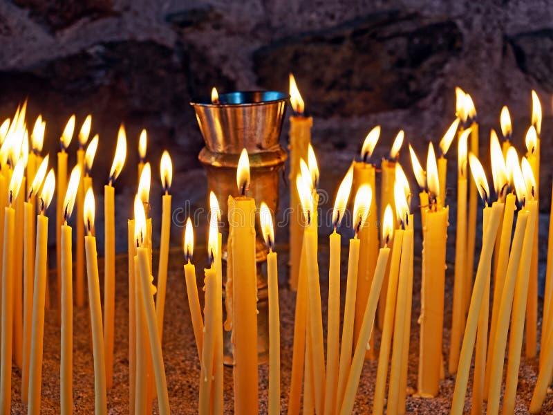 Lit Prayer Candles stock photos