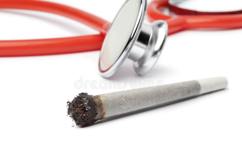 Lit reefer with stethoscope. Out of focus on background royalty free stock photography