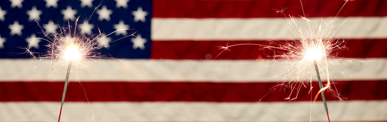 Sparklers in front the American Flag for 4th of July celebration royalty free stock photography