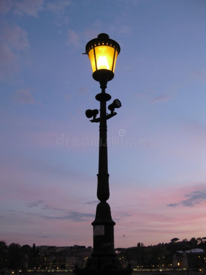 Lit street lamp royalty free stock images