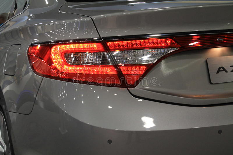 Lit tail lamp. Rear corner detail showing modern lit tail lamp. 2014 Hyundai Azera mid-luxury sedan on display at 2013 Miami International Auto Show stock photos