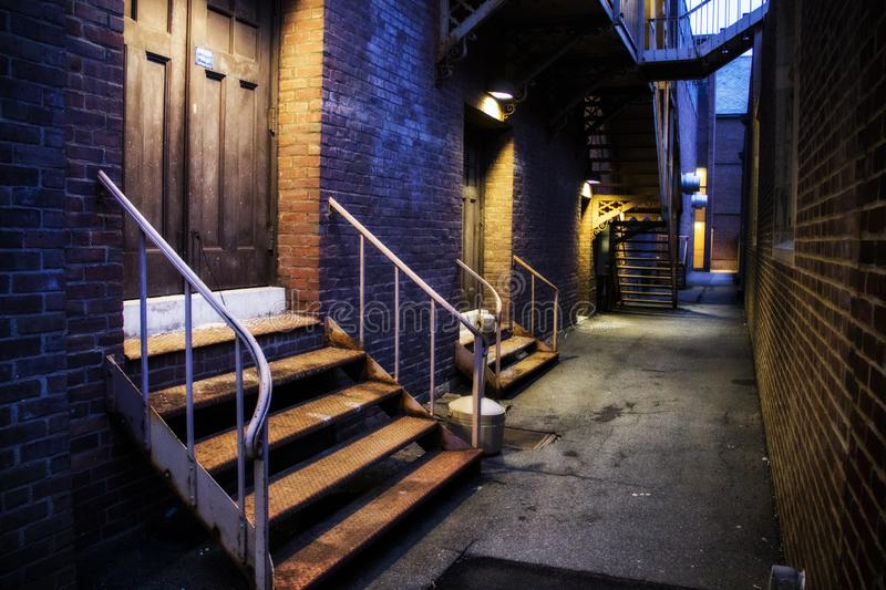 Lit up stairs in an alley royalty free stock photography