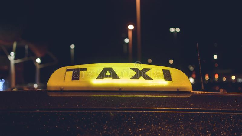 Lit Up Taxi Sign royalty free stock images