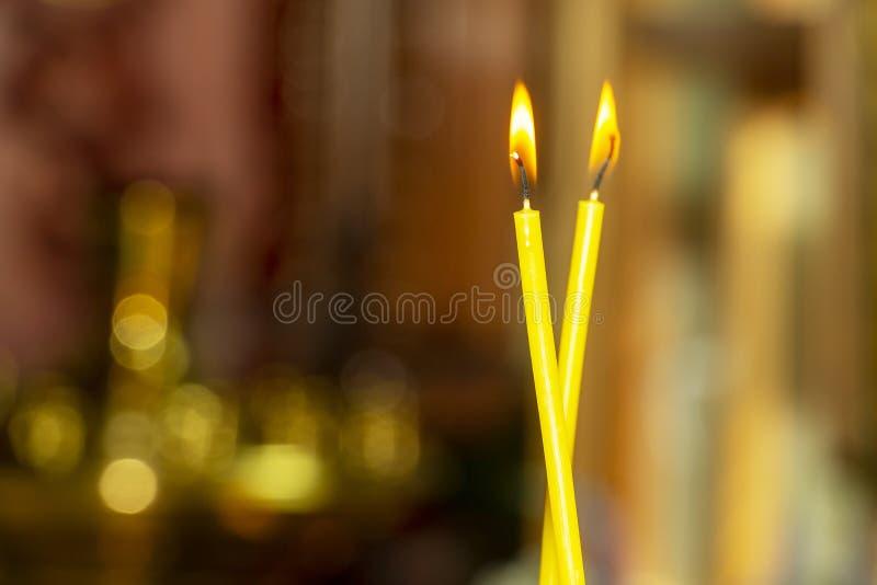 The lit, wax, church candles stock photos