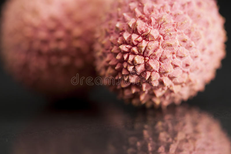 Litchi fruit with black background royalty free stock photos