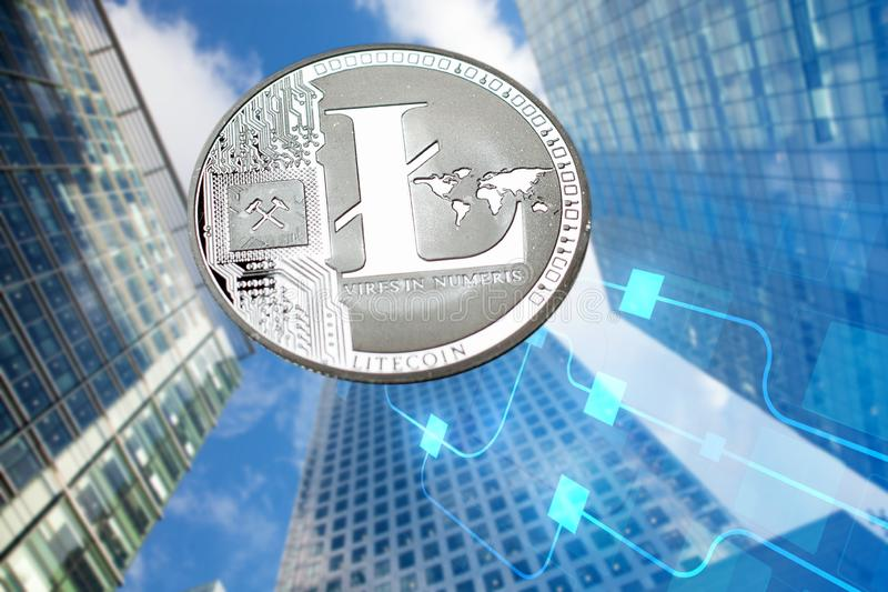 litecoin agains skyscrapers - futuristic smart city - cryptocurrency concept stock image
