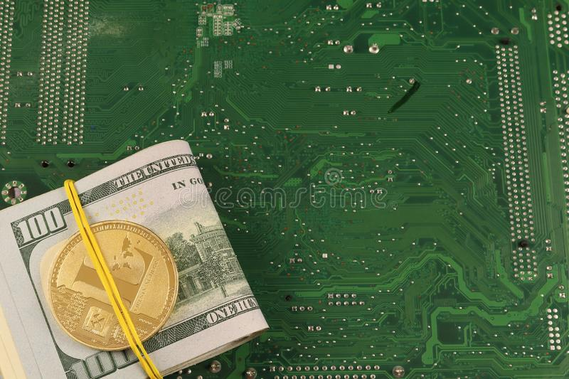 Litecoin on 100 american dollars banknotes, electronic board. Business concept of world digital money stock image