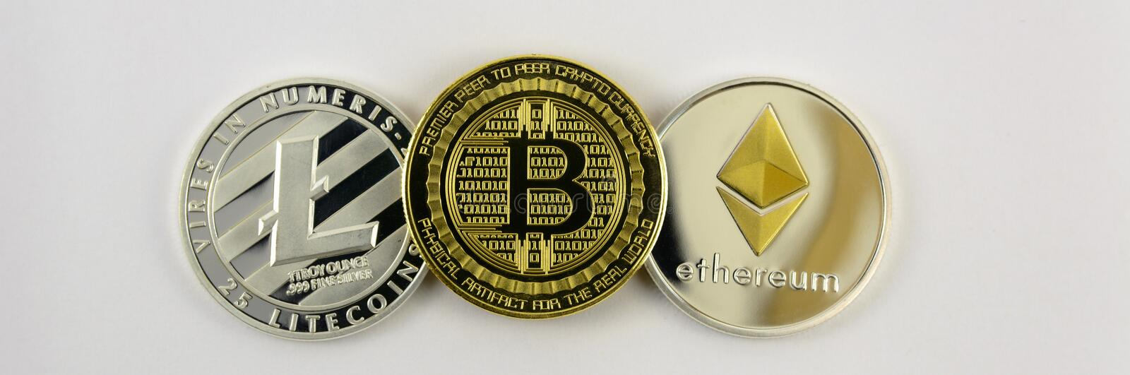 Litecoin, bitcoin en etheriumclose-up stock fotografie