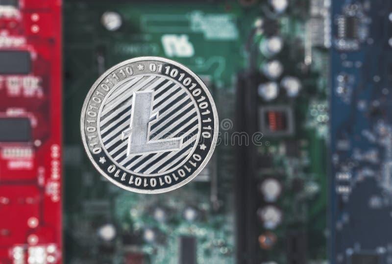 Litecoin en fondo del circuito integrado foto de archivo libre de regalías