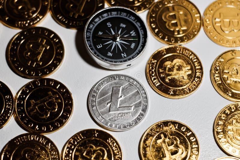 Litecoin kompas i moneta obraz stock
