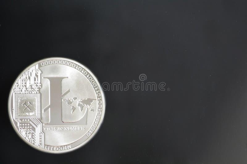 Litecoin, LTC, cryptocurrency moneta odizolowywająca na czarnym backgroun obraz royalty free