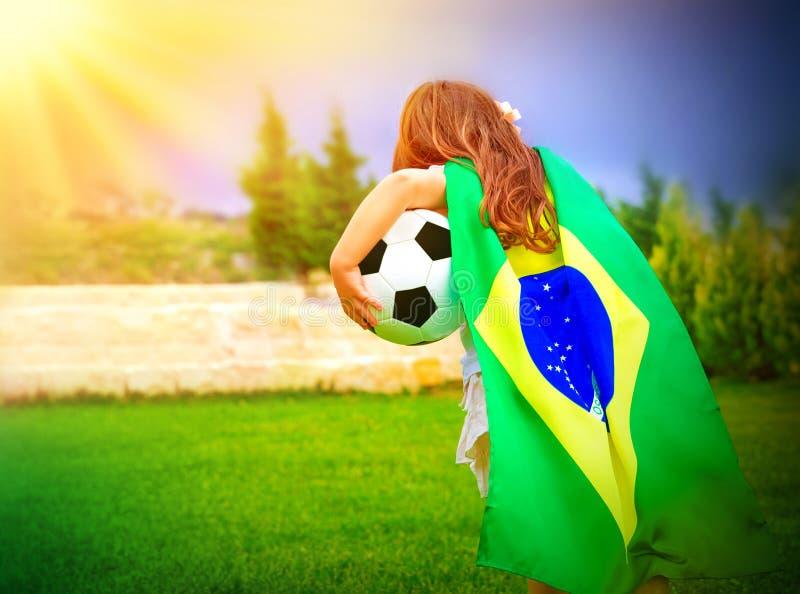 Liten aktiv fotbollsfan royaltyfria foton