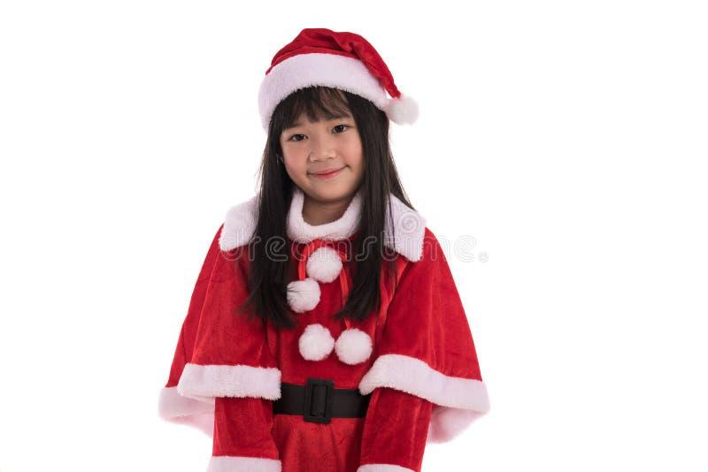 Liten asiatisk flicka i jul fotografering för bildbyråer