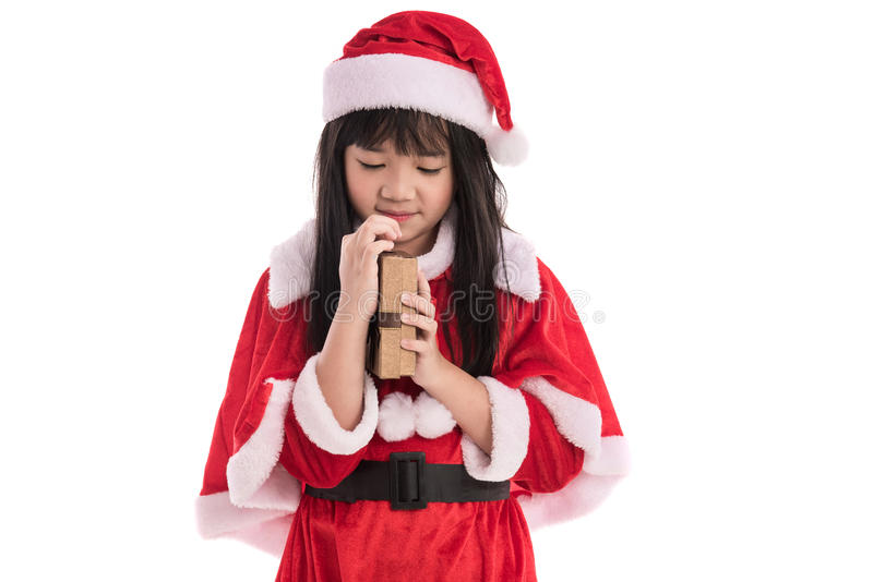 Liten asiatisk flicka i jul royaltyfria bilder
