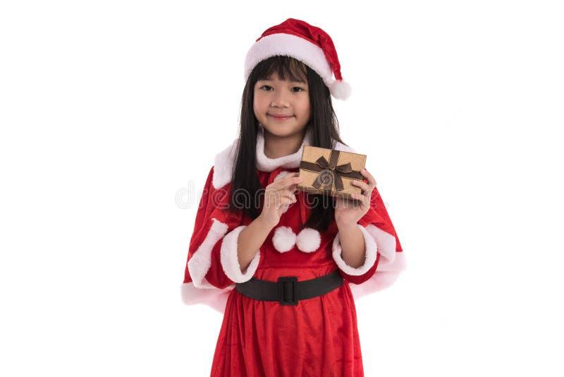 Liten asiatisk flicka i jul royaltyfri foto
