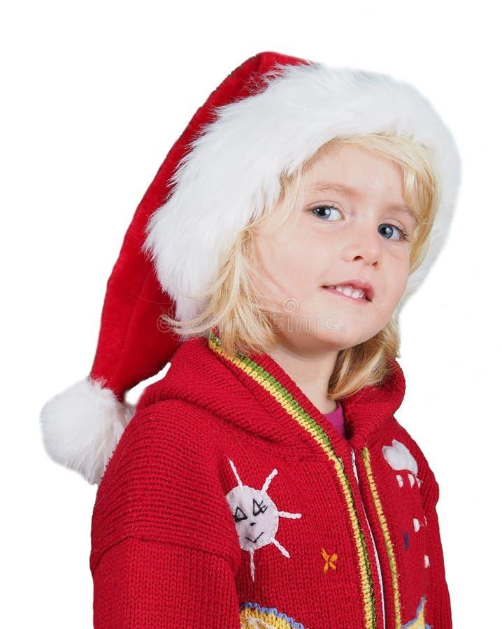 Liten flicka för lycklig jul med jultomtenhatten arkivbild